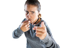 High angle portrait of female coach gesturing while whistling. Against white background Royalty Free Stock Photos