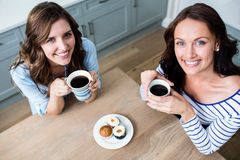 High angle portrait of female friends holding coffee mugs Royalty Free Stock Photo