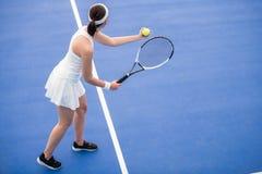 Female Tennis Player Serving Ball stock photo
