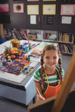 High angle portrait of girl painting on canvas. In classroom royalty free stock photography
