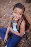 High angle portrait of girl sitting in forest Stock Photo