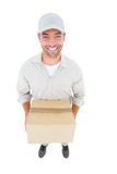 High angle portrait of handsome delivery man with cardboard box Royalty Free Stock Photography