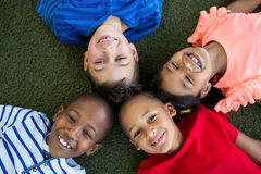High angle portrait of happy children forming huddle Royalty Free Stock Images