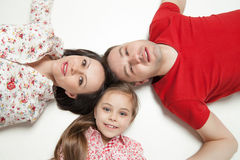 High angle portrait of happy family lying Royalty Free Stock Photos