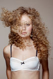 High angle portrait of the pretty young woman with beauty curly hairs Royalty Free Stock Photos