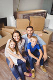 High angle portrait of smiling family with cardboard boxes Stock Photo
