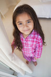 High angle portrait of a smiling girl in bedroom Stock Photo