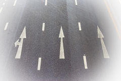 High angle of the road with white arrow Stock Photo