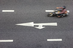 High angle of the road with white arrow,motion blur of motorcycl Royalty Free Stock Images