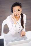 High angle shot of business woman sitting at the desk Stock Image
