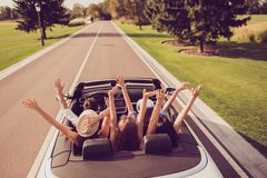 High angle shot of dreamy ladies and guy driver, chics girlfriends in headwear express emotions, success, euphoria, wind. Relax c. Hill destination, vehicle rent stock photos