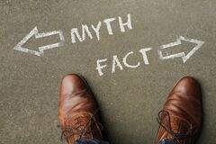 Free High Angle Shot Of Myth And Fact Marked With Opposite Directions On The Ground Stock Photos - 171965503