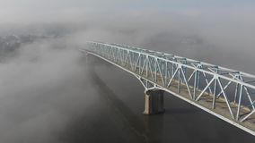 High Angle Forward Aerial View of Foggy Bridge Over Ohio River stock footage