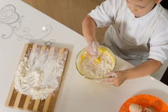 High angle of a small boy baking a cake Royalty Free Stock Images