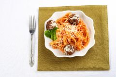 High angle spaghetti and meatballs in white bowl royalty free stock photo