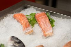 High Angle Still Life of Variety of Raw Fresh Fish Chilling on B. Ed of Cold Ice in Seafood Market Stall,Fresh seafood on ice in the showcase,Salmon on cooled Stock Photos