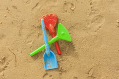 High angle summer beach colorful toys in the sand Royalty Free Stock Photography