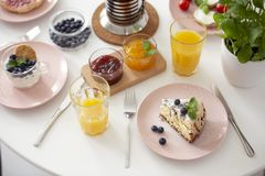 High angle on table with dessert, orange juice, marmalade during breakfast. Real photo royalty free stock photography