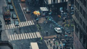 High Angle Timelapse View of Manhattan Pedestrians in the Rain. 9442 A high angle time lapse view of traffic and pedestrians with umbrellas on the streets of stock video