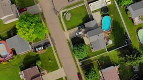 High angle top down forward flyover Pennsylvania neighborhood. A high angle top down forward flyover of a typical Pennsylvania residential neighborhood as car stock video footage