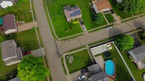 High Angle Top Down Reverse Flyover Pennsylvania Neighborhood. A high angle top down reverse flyover of a typical Pennsylvania residential neighborhood stock footage