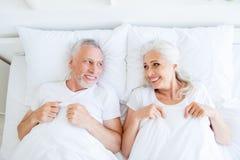 High angle top view of dreamy, couple in pajama, sleep, wear, sl stock photography