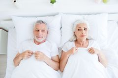 High angle top view of funky, joy, playful couple gray hair peop stock photography