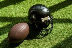 high angle view of american football ball and helmet