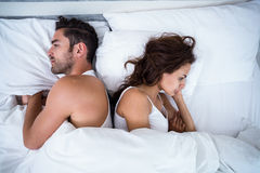 High angle view of angry couple on bed. At home Stock Photo