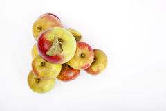 High angle view of apples forming pyramid over white background Royalty Free Stock Photo
