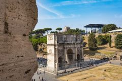 High angle view of the Arch of Constantine from the Colosseum. Rome, Italy - August 31, 2017: High angle view of the Arch of Constantine from the Colosseum at a Stock Images