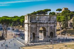 High angle view of the Arch of Constantine from the Colosseum. Rome, Italy - August 31, 2017: High angle view of the Arch of Constantine from the Colosseum at a Stock Image