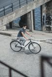 High angle view of asian teen in protective mask riding bicycle air. Pollution concept stock images