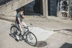 High angle view of asian teen in protective mask riding bicycle on bridge air. Pollution concept royalty free stock images