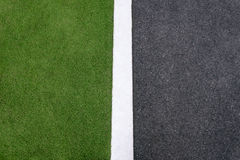 High angle view of asphalt of street and grass Royalty Free Stock Photo