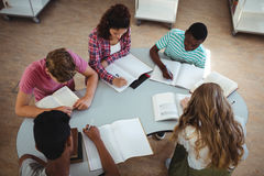 High angle view of attentive classmates studying in library Royalty Free Stock Photo