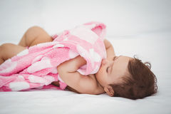 High angle view of baby holding blanket Royalty Free Stock Photo