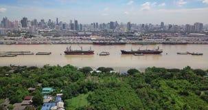 High angle view of Bangkok skyline and view of Chao Phraya River View from green zone in Bang Krachao, Phra Pradaeng, Samut Prakan. Province. Harbors and large stock video