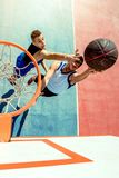 High angle view of basketball player dunking basketball in hoop Royalty Free Stock Photos