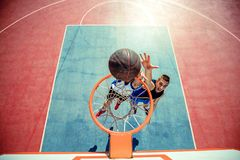 High angle view of basketball player dunking basketball in hoop Royalty Free Stock Photo