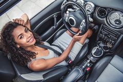 Mulatto girl in car Royalty Free Stock Photo