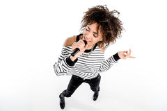High angle view of beautiful young woman with microphone singing isolated on white Stock Photography