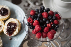 High angle view of berry fruits in bowl on table Royalty Free Stock Photo