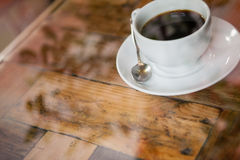 High angle view of black coffee on wooden table. At cafe shop Royalty Free Stock Image
