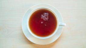 High angle view of black tea cup. High angle view black tea cup royalty free stock image