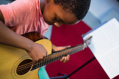 High angle view of boy playing guitar Royalty Free Stock Photos