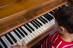 High angle view of boy playing piano in classroom Stock Photos