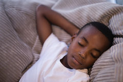 High angle view of boy sleeping on couch Royalty Free Stock Image