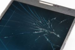 High angle view of broken smart phone over white background. High angle view of a broken smart phone over white background royalty free stock images