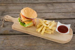 High angle view on burger with French fries and sauce Stock Image